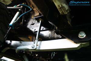 """Front left view of the fitted Superior Hyperflex Radius Arm, 2.5 OEM 4"""" King Shocks Lift, Superflex Sway Bar Kit, Coil Springs, Superior Hydraulic Front Bump Stop Kit"""