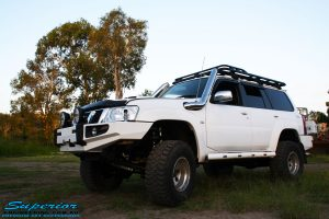 Left front side view of a White Nissan GU Patrol Wagon after fitment of a range of high quality Superior Engineering 4x4 Suspension & Accessories