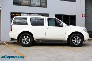 Right side view of a White Nissan R51 Pathfinder Wagon before fitment of a Tough Dog 40mm Lift Kit