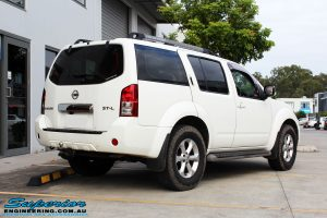 Rear right view of a White Nissan R51 Pathfinder Wagon before fitment of a Tough Dog 40mm Lift Kit