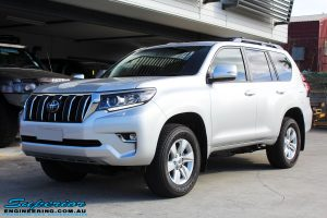 """Left front side view of a Silver Toyota 150 Landcruiser Prado Wagon before fitment of a Superior Remote Reservoir 2"""" Inch Lift Kit"""