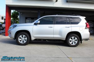"""Left side view of a Silver Toyota 150 Landcruiser Prado Wagon before fitment of a Superior Remote Reservoir 2"""" Inch Lift Kit"""
