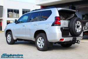 """Rear left view of a Silver Toyota 150 Landcruiser Prado Wagon before fitment of a Superior Remote Reservoir 2"""" Inch Lift Kit"""