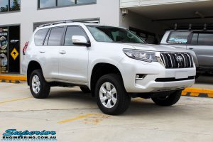 """Right front side view of a Silver Toyota 150 Landcruiser Prado Wagon after fitment of a Superior Remote Reservoir 2"""" Inch Lift Kit"""