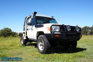 """Right front side view of a Toyota Landcruiser 79 Series after fitting a Superior Coil Conversion 2"""" Inch Rear Kit"""