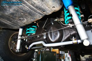 Right rear side view of the fitted Superior Nitro Gas Shock Absorber with Coil Spring, Lower Control Arm, Upper Control Arm and Sway Bar Kit