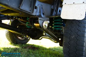 Close up left side view of the fitted Superior Nitro Gas Shock Absorber with Coil Spring, Lower Control Arm, Upper Control Arm and Sway Bar Kit