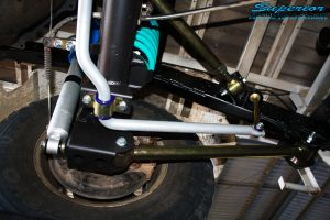 Left rear view looking up on the fitted Superior Nitro Gas Shock Absorber with Coil Spring, Lower Control Arm, Upper Control Arm and Sway Bar Kit