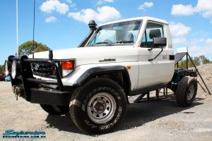 """Left front side view of a Toyota Landcruiser 79 Series after fitting a Superior 2"""" Inch Rear Coil Conversion Kit"""