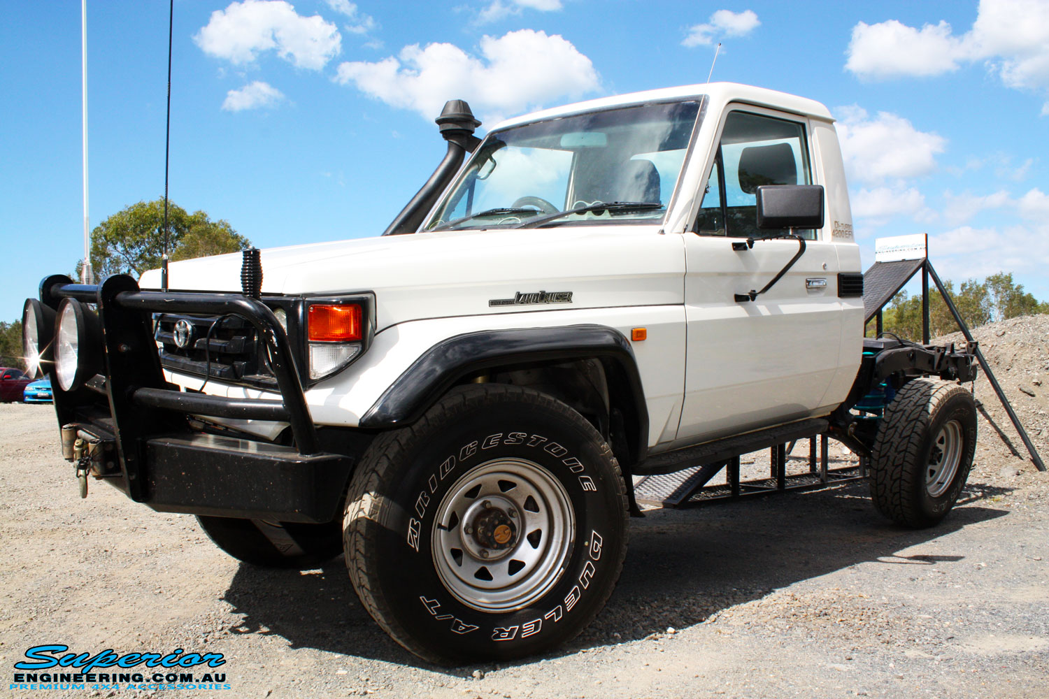 "Left front side view of a Toyota Landcruiser 79 Series after fitting a Superior 2"" Inch Rear Coil Conversion Kit"