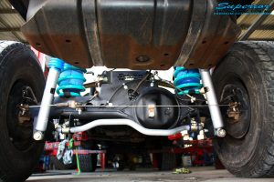 "Rear underbody view of the fitted fitted Superior 2"" Inch Nitro Gas Shock Absorbers, Coil Springs with Airbag Man Coil Air Kit and Sway Bar Kit"