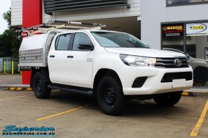 """Right front side view of a White Toyota Revo Hilux Dual Cab before fitment of a Bilstein 2"""" Inch Lift Kit"""