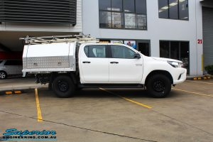 """Right side view of a White Toyota Revo Hilux Dual Cab before fitment of a Bilstein 2"""" Inch Lift Kit"""