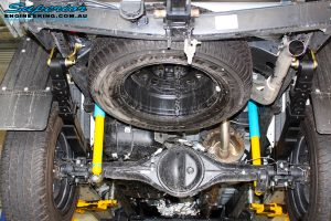 "Rear underbody shot of the fitted Bilstein 2"" Shocks with EFS Leaf Springs and U-Bolt Kit"