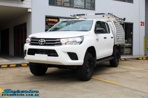 "Left front side view of a White Toyota Revo Hilux Dual Cab after fitment of a Bilstein 2"" Inch Lift Kit"