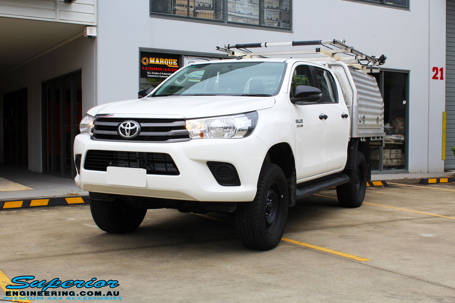 """Left front side view of a White Toyota Revo Hilux Dual Cab after fitment of a Bilstein 2"""" Inch Lift Kit"""