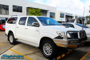 "Right front side view of a Toyota Vigo Hilux Dual Cab before fitment of a Superior Remote Reservoir 2"" Inch Lift Kit"