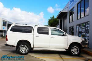 """Right side view of a Toyota Vigo Hilux Dual Cab before fitment of a Superior Remote Reservoir 2"""" Inch Lift Kit"""