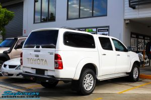 """Rear right view of a Toyota Vigo Hilux Dual Cab before fitment of a Superior Remote Reservoir 2"""" Inch Lift Kit"""