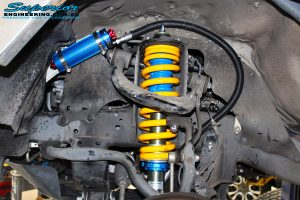 """Front left inside guard view of the fitted front Superior 2"""" Adjustable Monotube Remote Reservoir Strut + Coil Spring"""