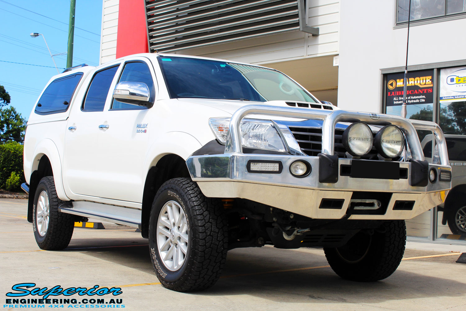 "Right front side view of a Toyota Vigo Hilux Dual Cab after fitment of a Superior Remote Reservoir 2"" Inch Lift Kit"