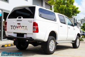 "Rear right view of a Toyota Vigo Hilux Dual Cab after fitment of a Superior Remote Reservoir 2"" Inch Lift Kit"