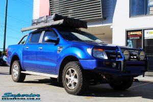 """Right front side view of a Ford PXII Ranger in Blue before fitment of a Superior Nitro Gas 2"""" Inch Lift Kit"""