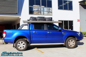 """Right side view of a Ford PXII Ranger in Blue before fitment of a Superior Nitro Gas 2"""" Inch Lift Kit"""