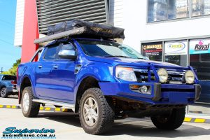 "Right front side view of a Ford PXII Ranger in Blue after fitment of a Superior Nitro Gas 2"" Inch Lift Kit"