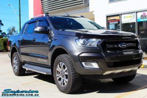 """Right front side view of a Ford PXII Ranger in Grey before fitment of a Superior Nitro Gas 2"""" Inch Lift Kit"""