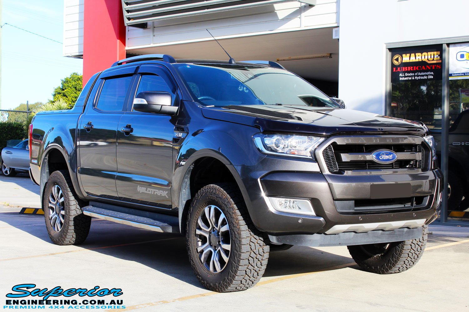"Right front side view of a Ford PXII Ranger in Grey after fitment of a Superior Nitro Gas 2"" Inch Lift Kit"