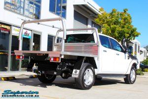 Rear right view of a Ford PXII Ranger in White On The Hoist @ Superior Engineering Deception Bay Showroom