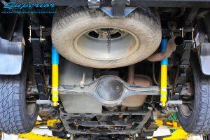 "Rear underbody shot of the fitted Bilstein 2"" Rear Shocks, EFS Leaf Springs & U-Bolt Kit"
