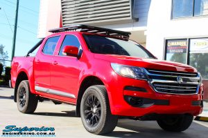 Right front side view of a Absolute Red Holden Colorado RG before fitment of a Bilstein 45mm Lift Kit