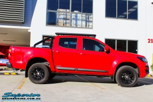 Side view of a Absolute Red Holden Colorado RG before fitment of a Bilstein 45mm Lift Kit