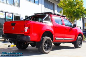 Rear right view of a Absolute Red Holden Colorado RG after fitment of a Bilstein 45mm Lift Kit