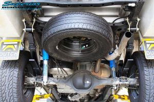 "Rear underbody shot of the fitted Superior Nitro Gas 2"" Shocks + EFS Leaf Springs with U-Bolt Kit"