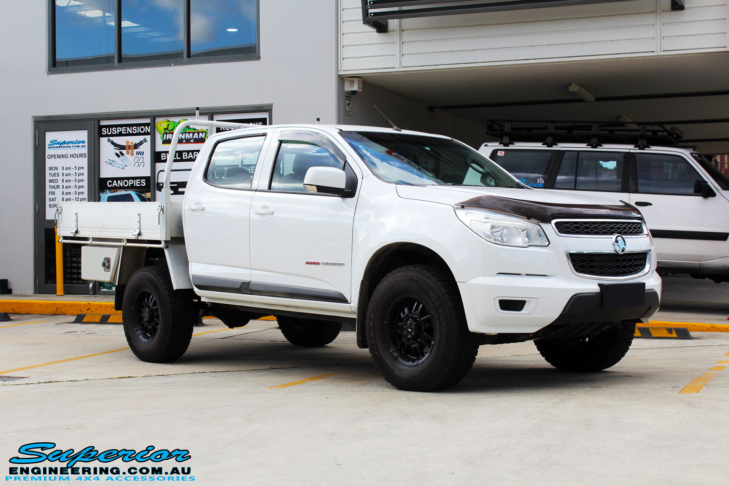 "Right front side view of a White Holden RG Colorado Dual Cab after fitment of a Superior Nitro Gas 2"" Inch Lift Kit"