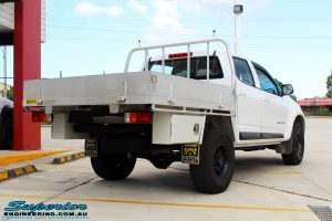 """Rear right view of a White Holden RG Colorado Dual Cab after fitment of a Superior Nitro Gas 2"""" Inch Lift Kit"""