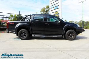 Side right view of a Black Isuzu D-Max Dual Cab before fitment of a Dobinson 40mm Lift Kit