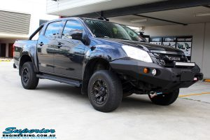 Right front side view of a Black Isuzu D-Max Dual Cab before fitment of a Dobinson 40mm Lift Kit