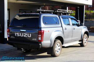 Rear right view of a Blue Isuzu D-Max Dual Cab before fitment of a Safari Snorkel & MCC 4x4 Bull Bar
