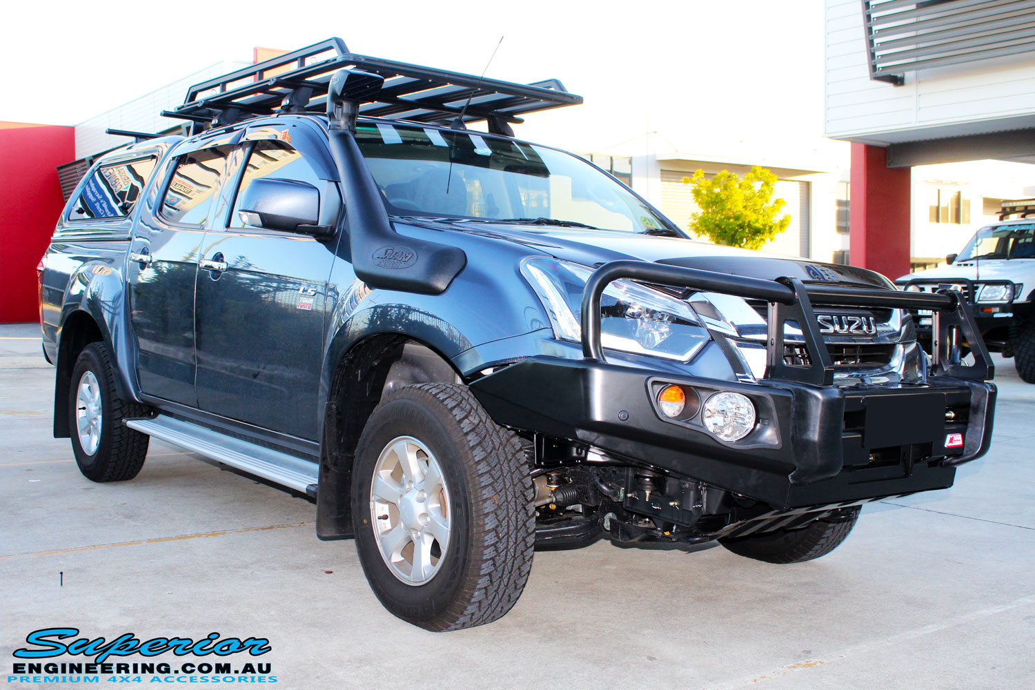 Right front side view of a Blue Isuzu D-Max Dual Cab after fitment of a Safari Snorkel & MCC 4x4 Bull Bar