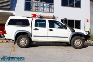 Side view of a White Isuzu D-Max Dual Cab before fitment of a Bilstein 40mm Lift Kit