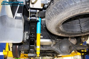 Rear Left Underbody view of the fitted Bilstein 40mm Shock with Leaf Spring & U-Bolt Kit