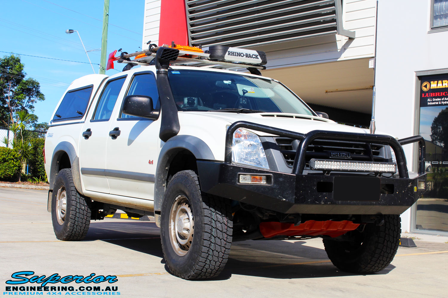 Right front side view of a White Isuzu D-Max Dual Cab after fitment of a Bilstein 40mm Lift Kit