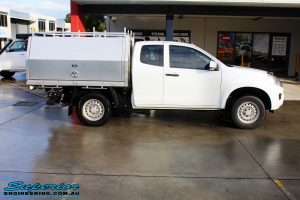 """Right side view of a White Isuzu D-Max Dual Cab before fitment of a Superior Nitro Gas 2"""" Inch Lift Kit"""