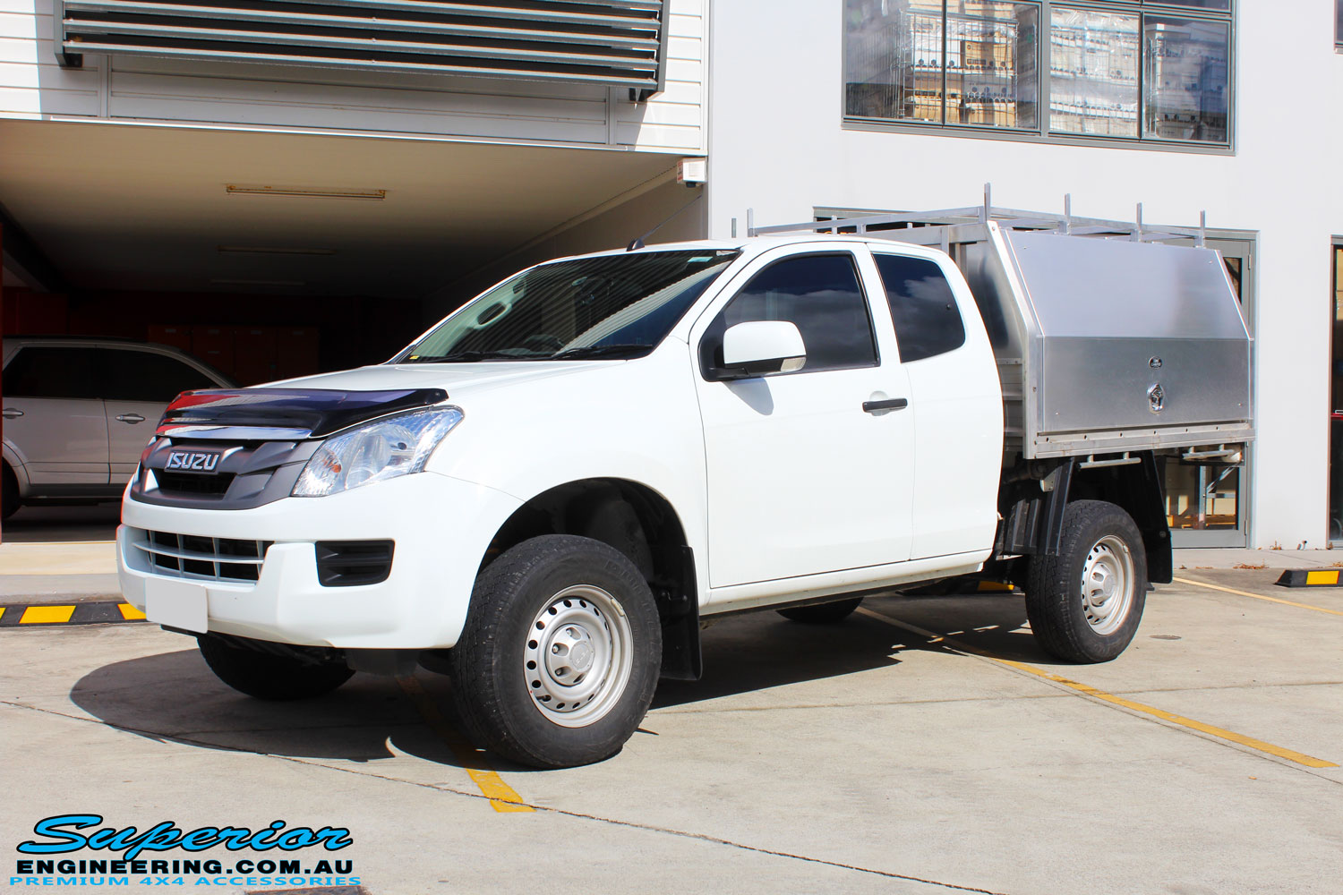 "Left front side view of a White Isuzu D-Max Dual Cab after fitment of a Superior Nitro Gas 2"" Inch Lift Kit"