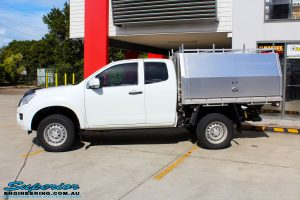 """Left side view of a White Isuzu D-Max Dual Cab after fitment of a Superior Nitro Gas 2"""" Inch Lift Kit"""