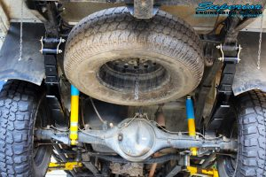 """Rear mid underbody view of a fitted Bilstein 2"""" Inch Rear Shocks with Leaf Springs + U-Bolt Kit"""